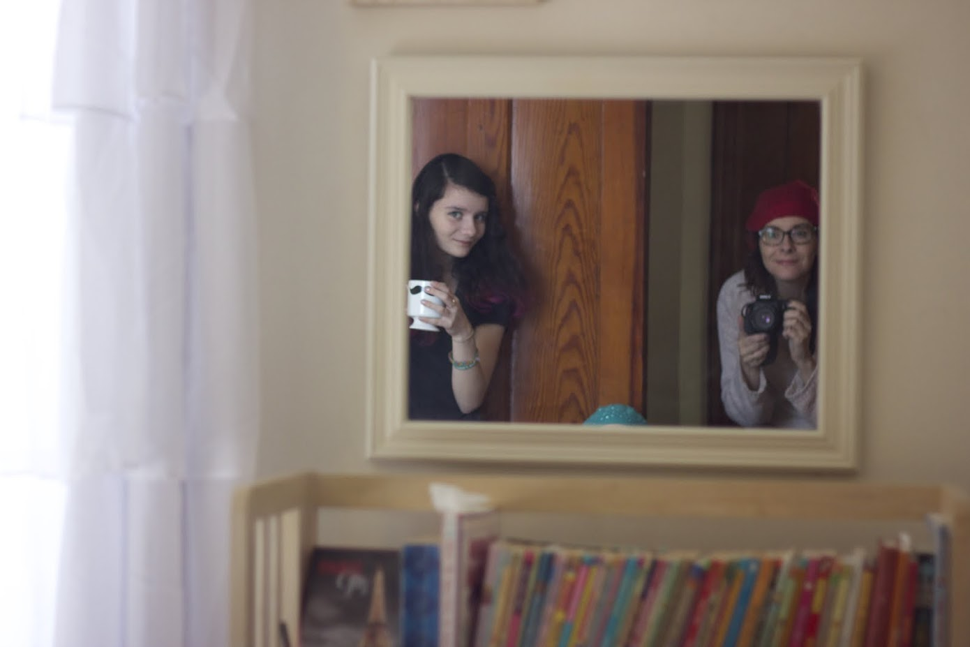 reflection of two girls in the mirror