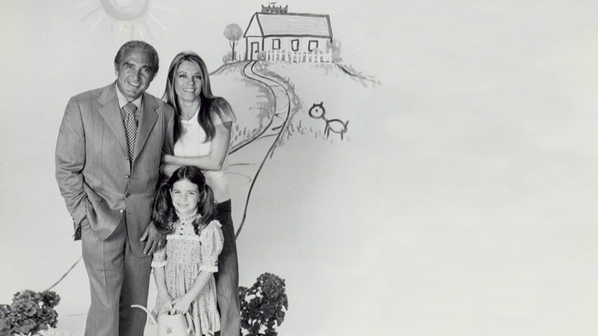 family standing infront of drawing of a house