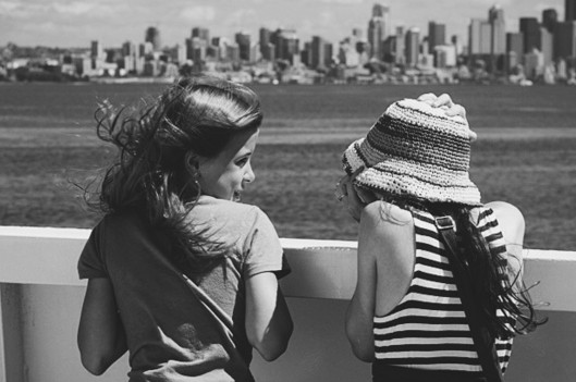 Two girls talking on the ferry