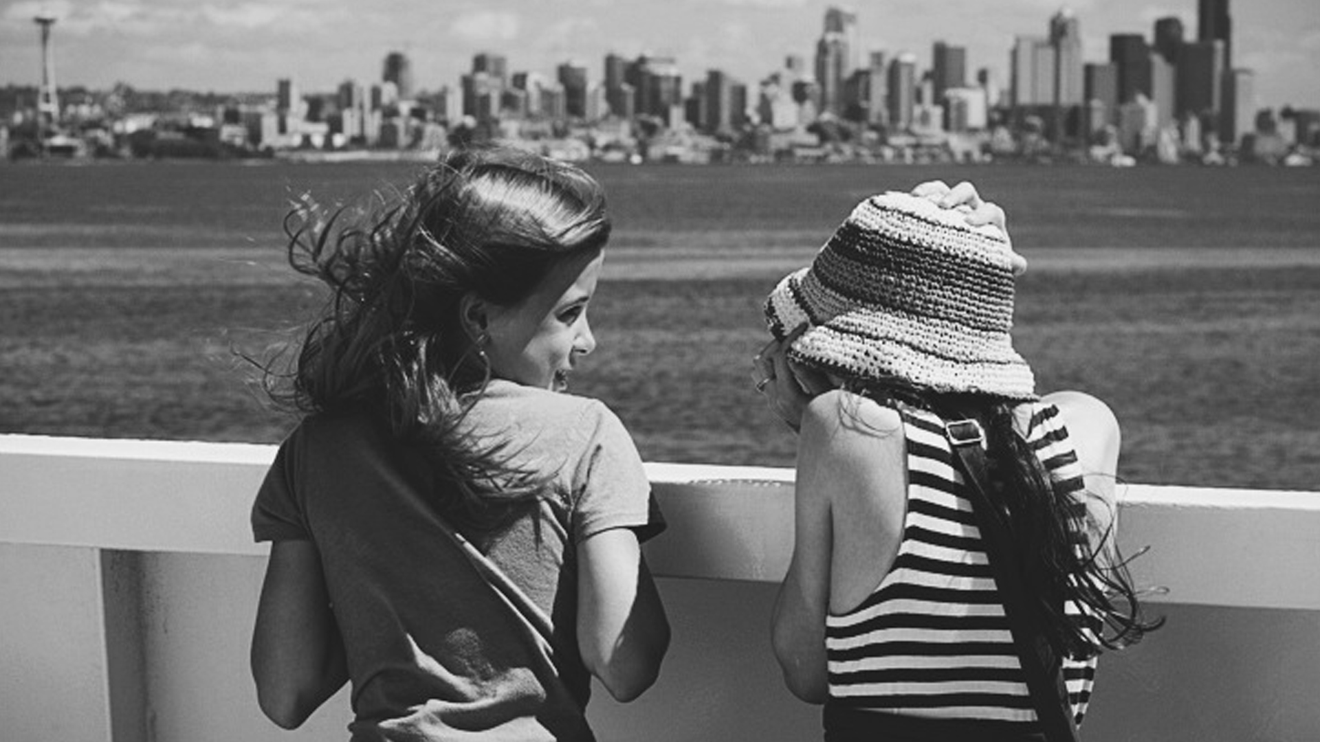 an introvert and her camera two girls talking on the ferry