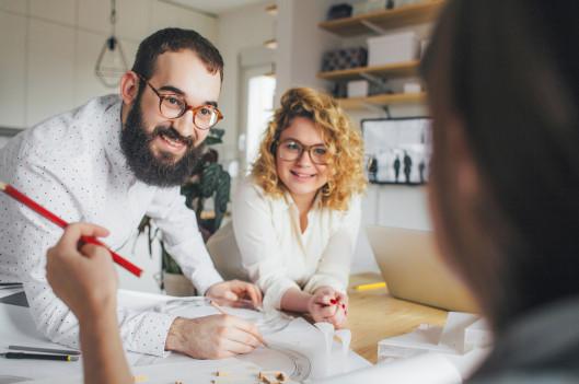 Co-workers listen in as woman speaks