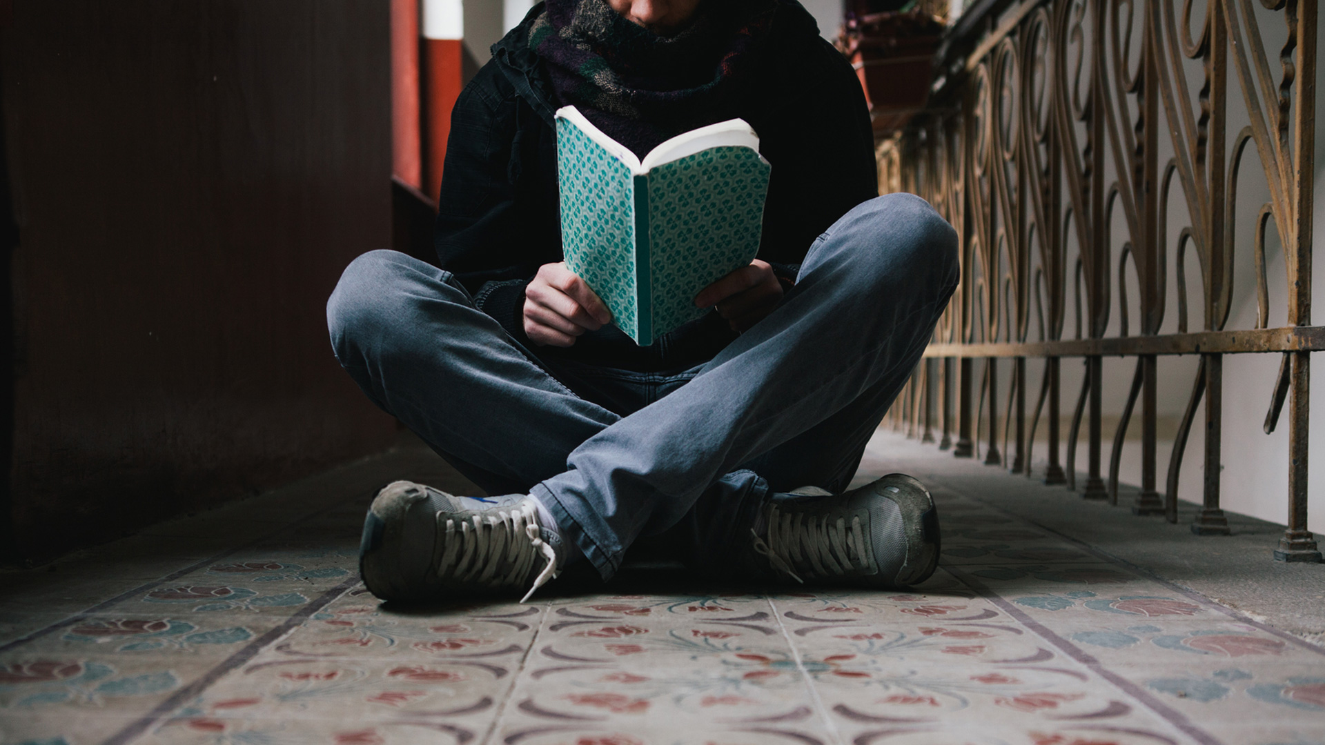 Boy reading in the hall