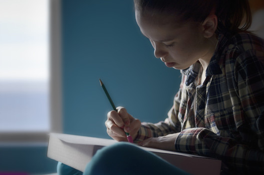 girl erasing her homework