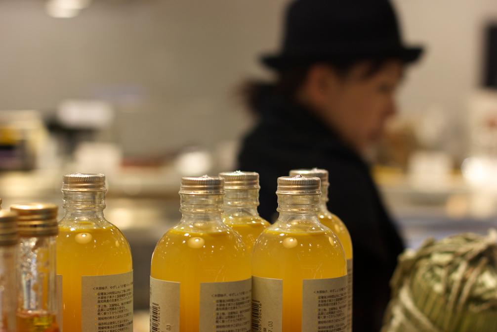 woman in amongst glass bottles