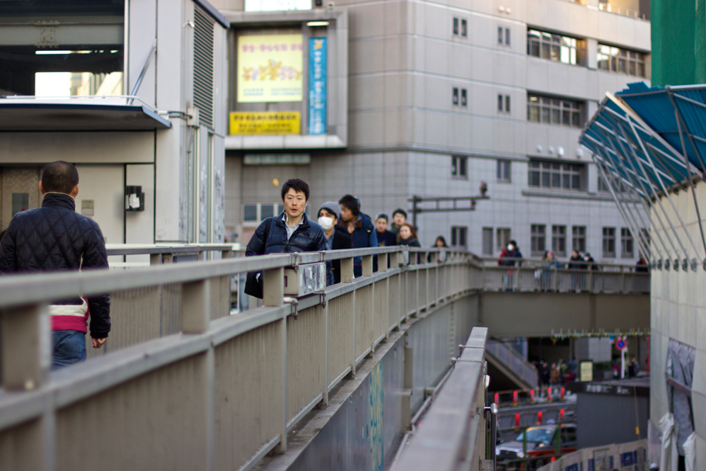 view of people walking on an overpass
