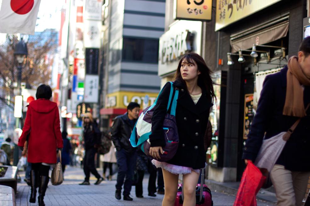 woman walking in the street looking away