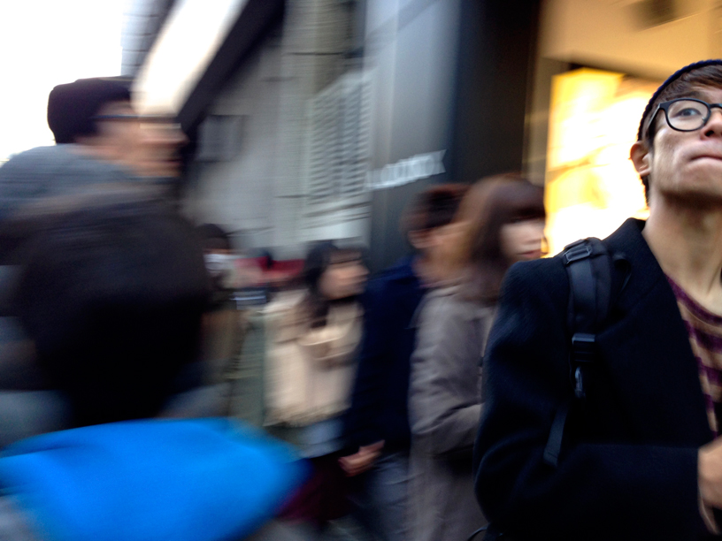 Blurry image of people on the street