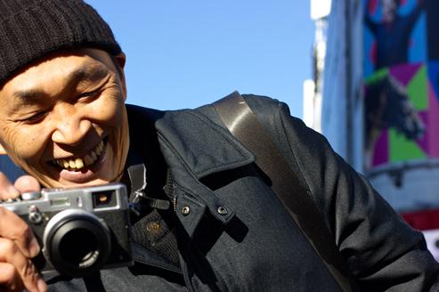 Man looking at his camera smiling