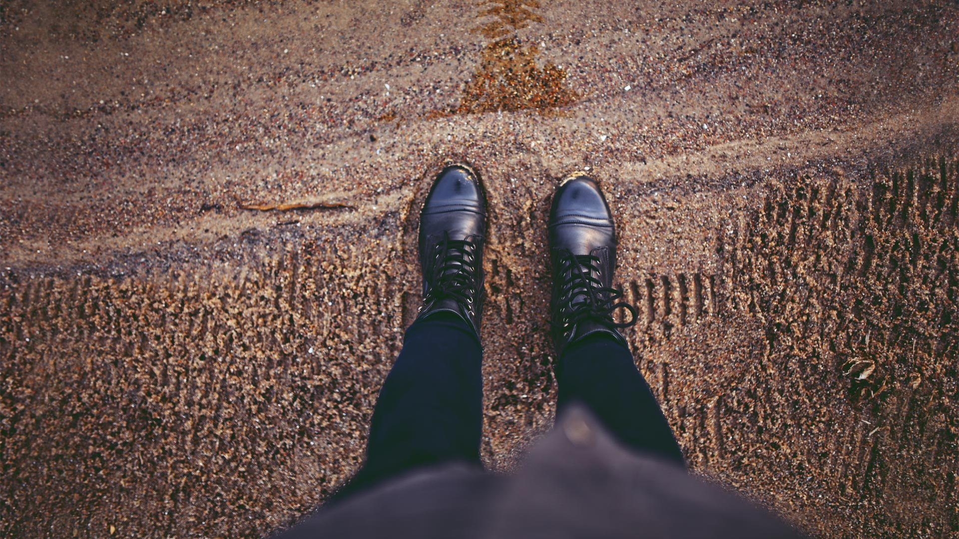 Woman's feet on the sand