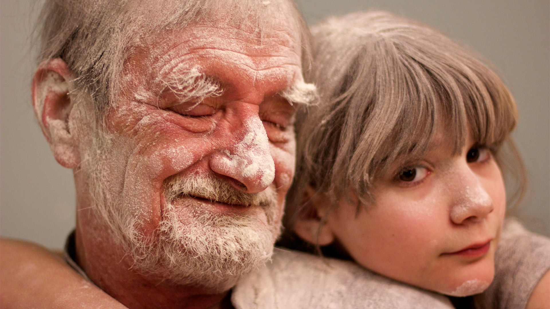 Girl and Grandfather Covered in Flour | My Father the Introvert: A Photo Essay