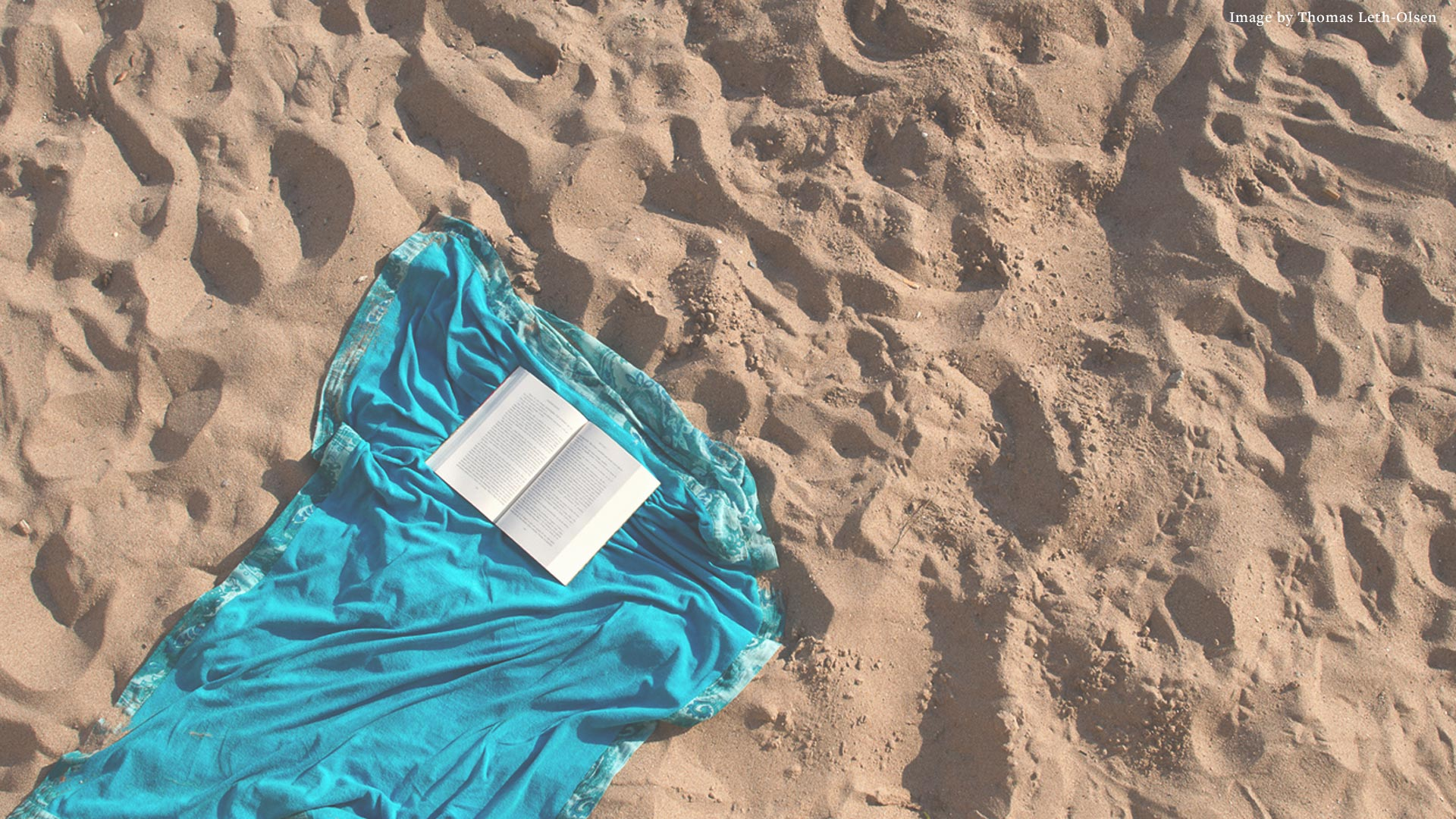Open book on the sand