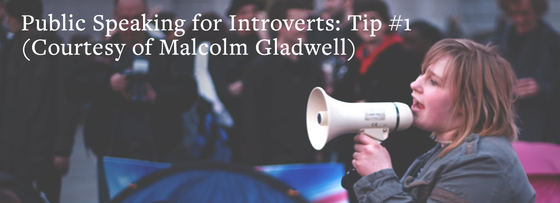 Woman with loudspeaker | Public speaking for introverts: tip #1 (courtesy of Malcolm Gladwell)