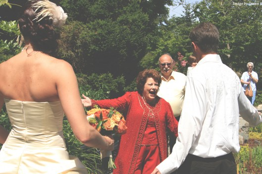 mother in law greeting son at wedding