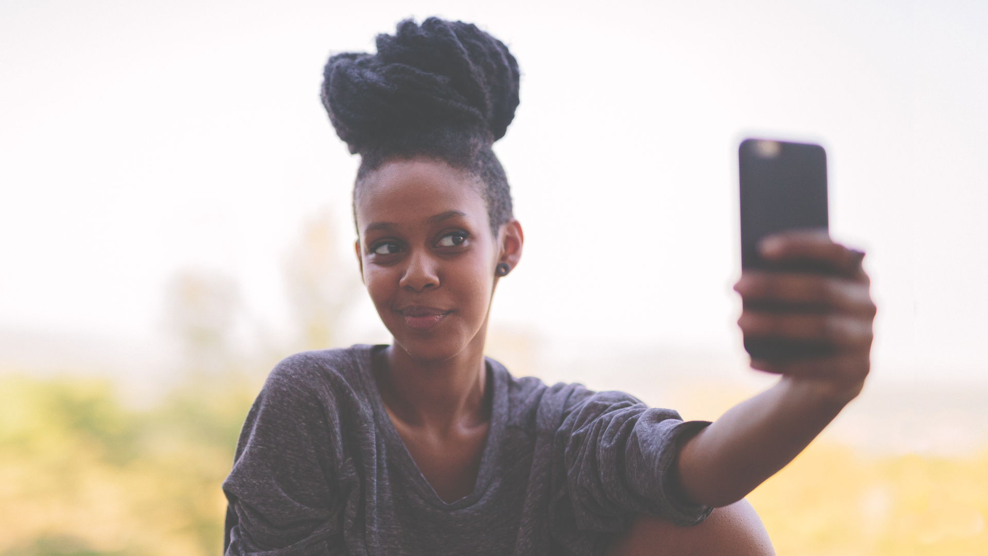Woman taking a selfie on her phone