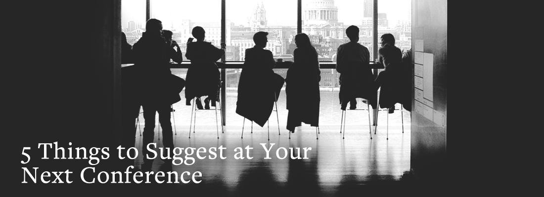 Silhouettes of people sitting at a conference table | 5 Things to Suggest at Your Next Conference