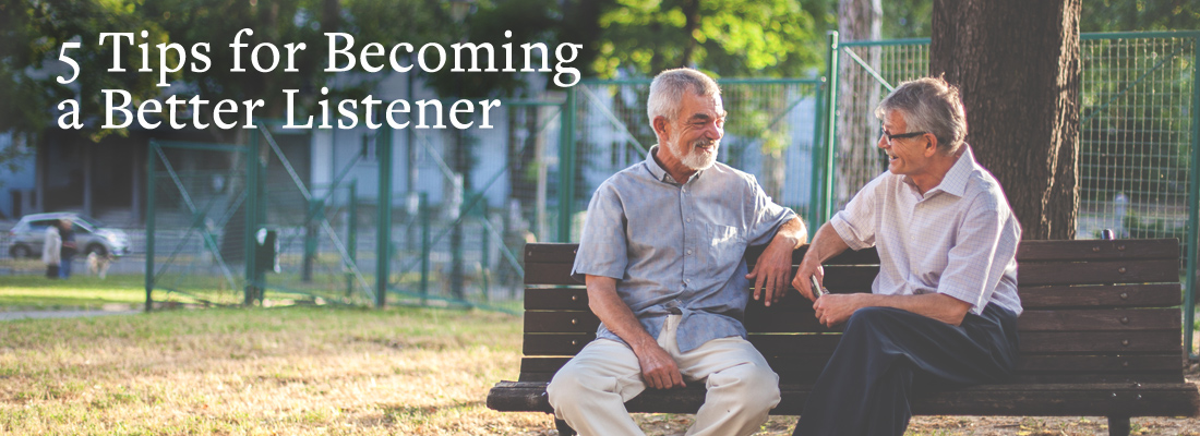 Two older men chatting on a park bench | 5 Tips for Becoming a Better Listener