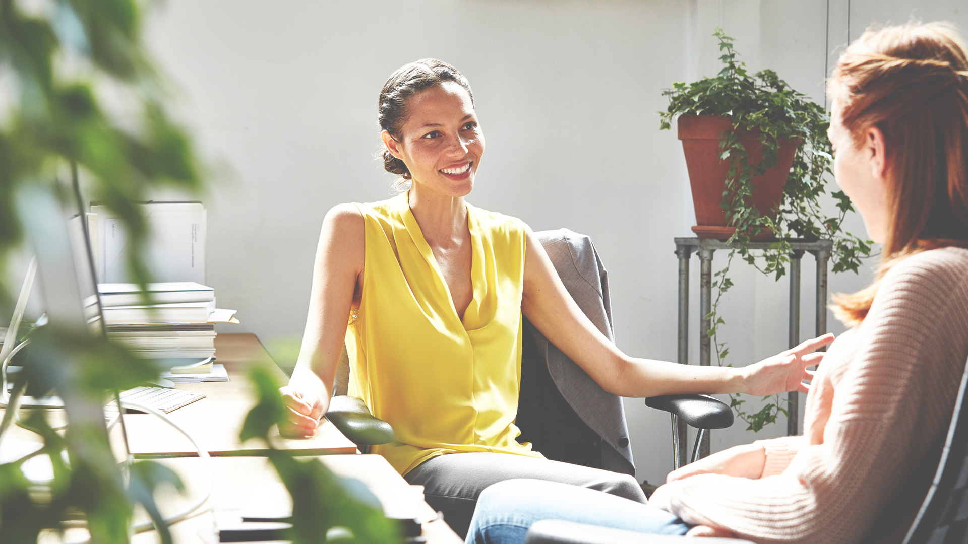 Two women talking at the office