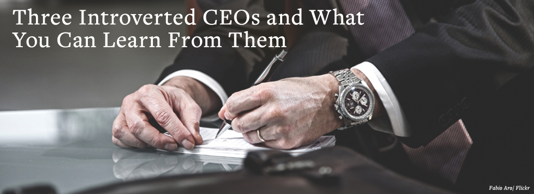 Businessperson writing on desk | Three Introverted CEOs and What You Can Learn From Them