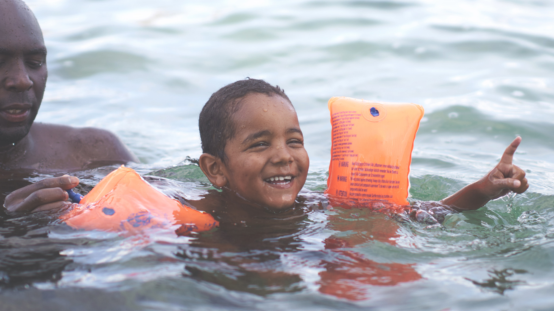 Boy with floaties in the water