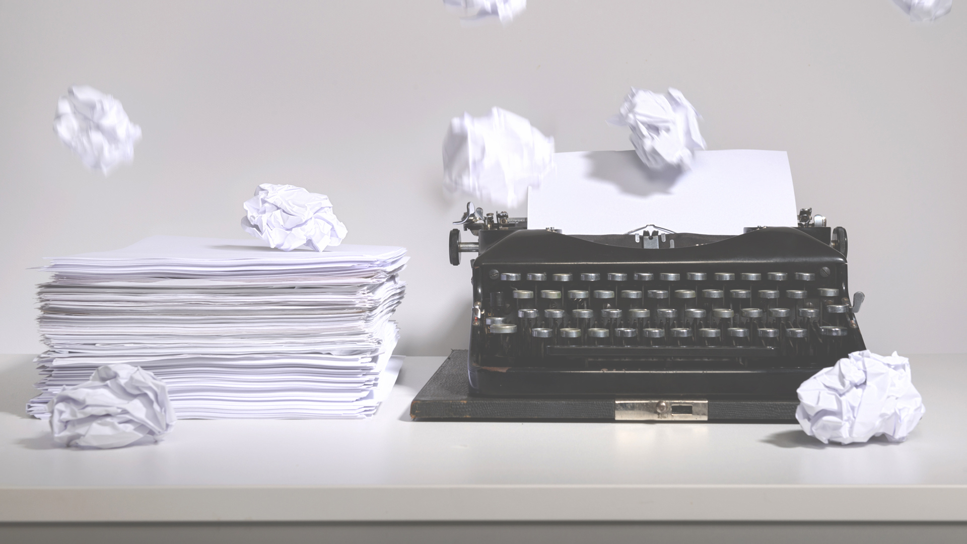 typewriter and sheets of paper