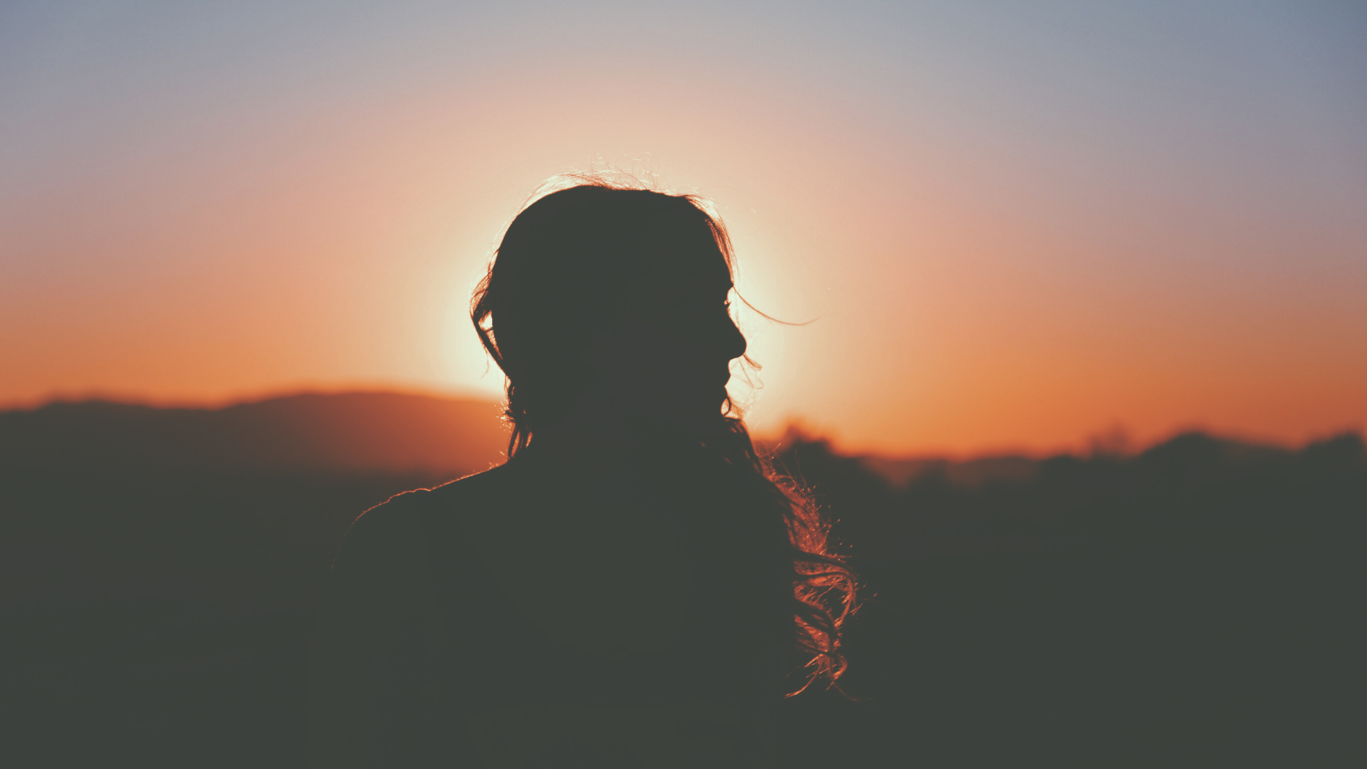 Woman silhouette against the sunset