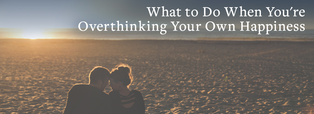 Couple on beach | What To Do When You're Overthinking Your Own Happiness