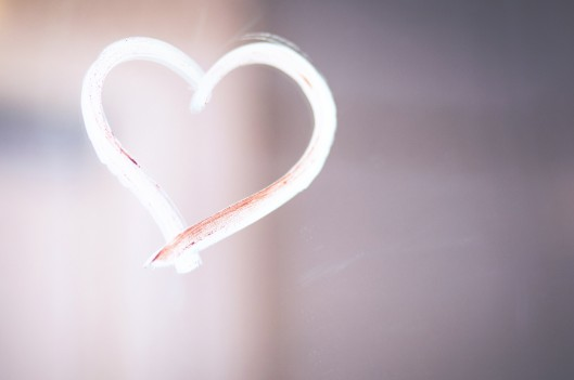 Lipstick heart on glass