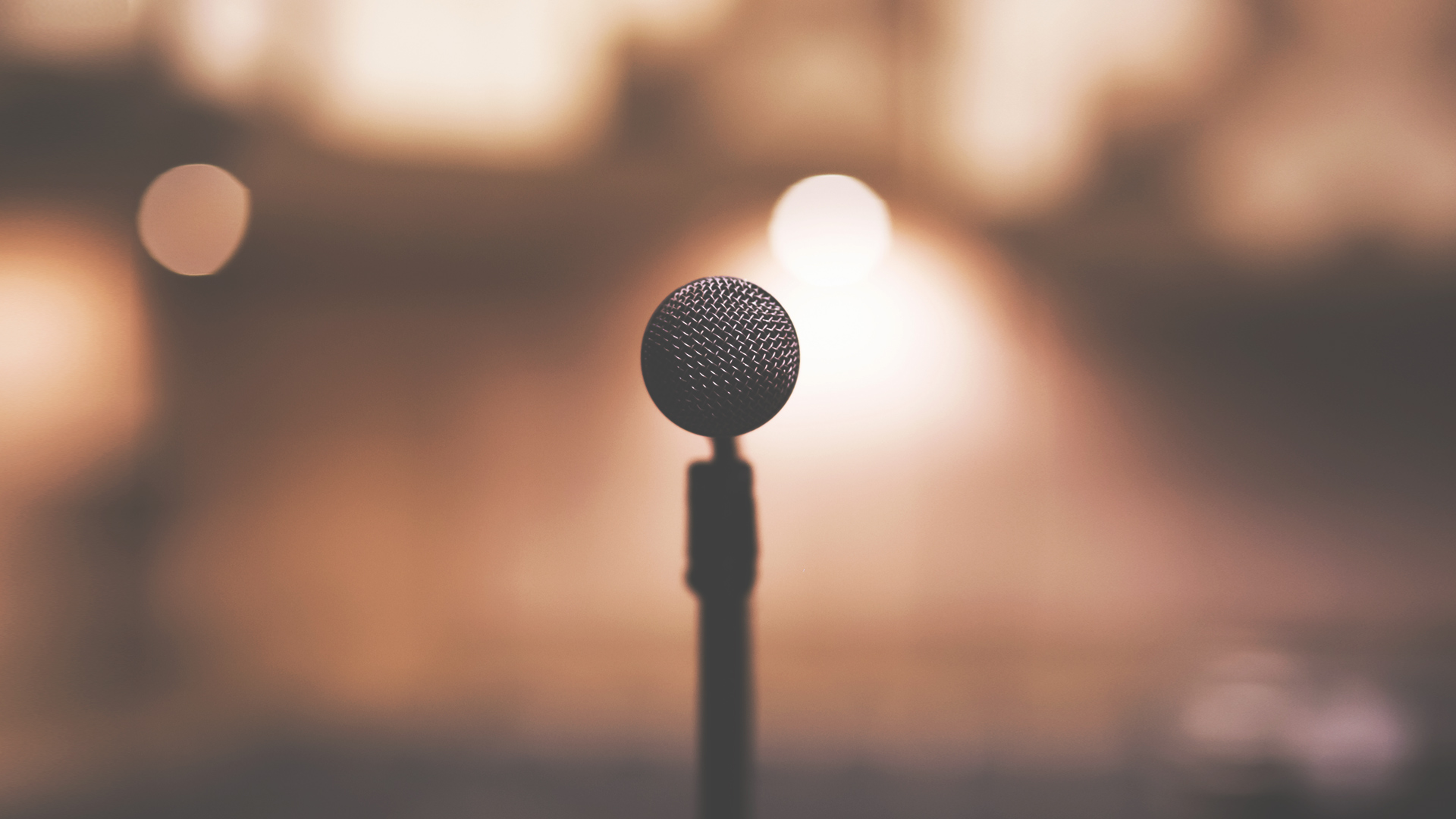 An introverted papa tackles karaoke quiet revolution microphone on stage urtaz Images