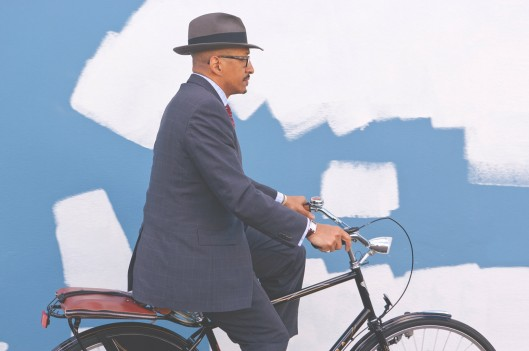 Business man riding his bicycle to work