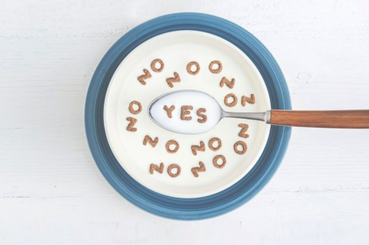 Cereal bowl with letters forming yes and no
