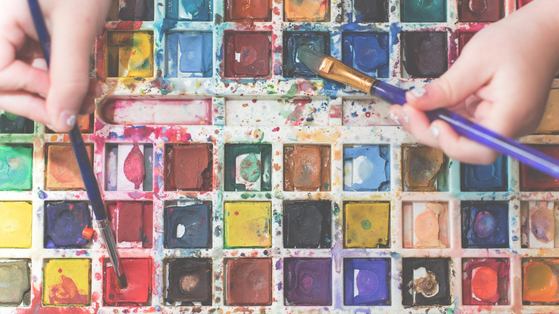 Kids using water color paints