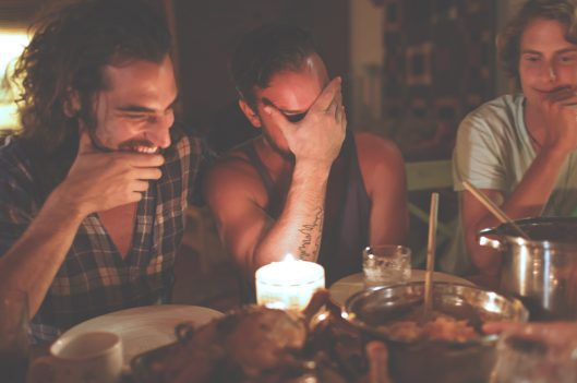 People laughing at the dinner table