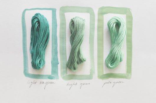 Three different colored pieces of yarn