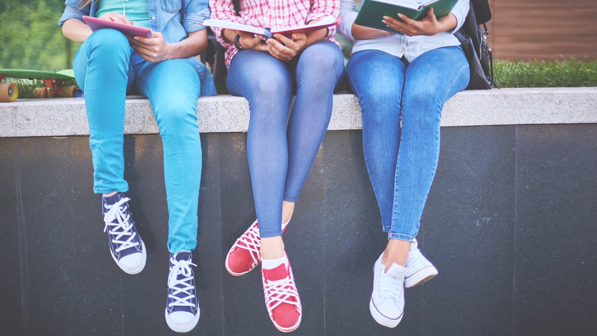 High school girls sitting with their books