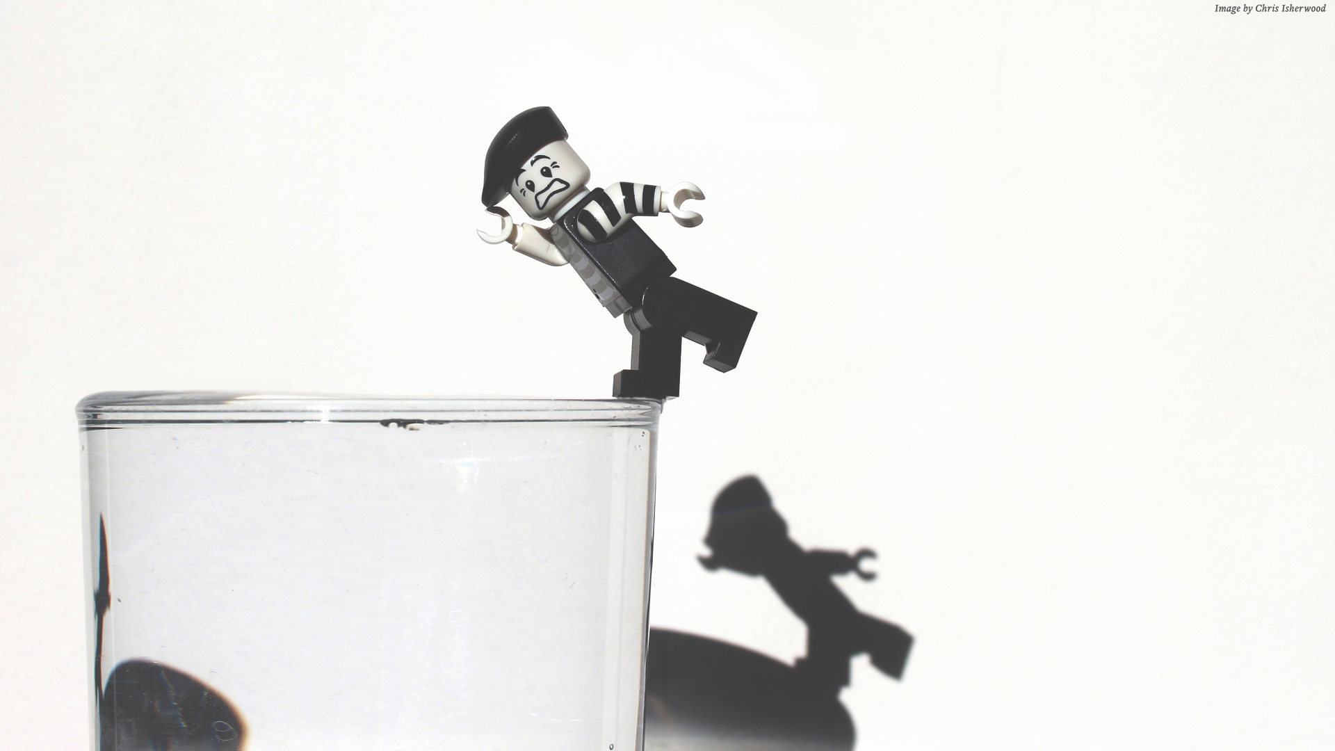 Lego mime falling into a glass of water