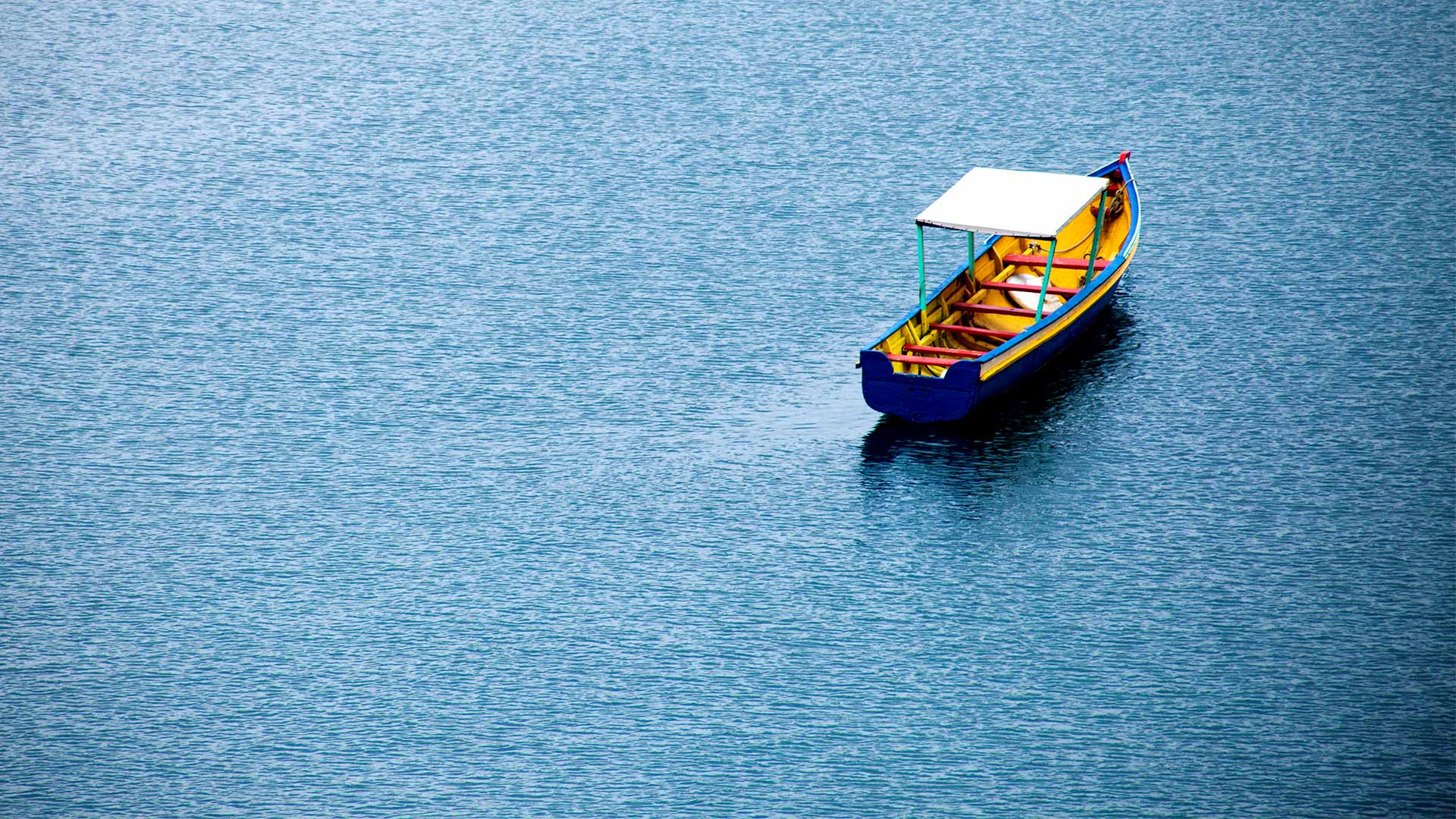 Photo of an empty skiff on water