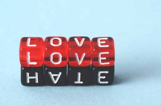 Dice with LOVE and HATE written on them