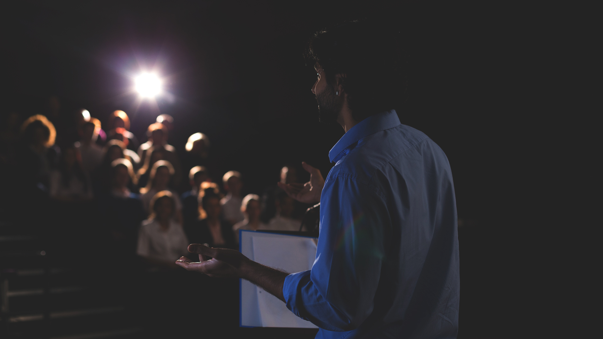 Man giving a speech in front of a crowd