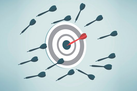 Target with one dart in bulls eye