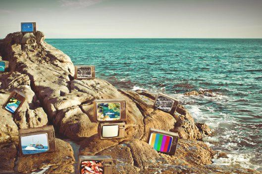 TVs on beach rocks