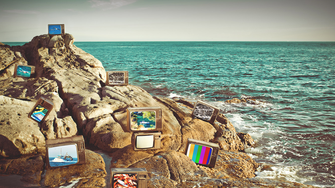 TVs on beach rocks