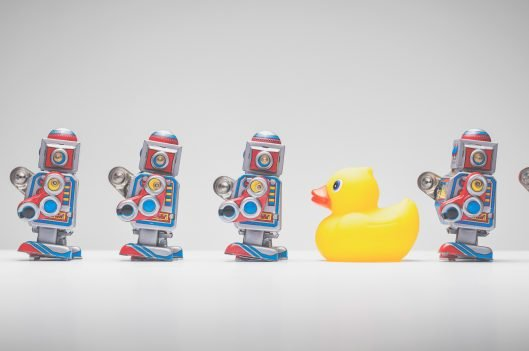 Rubber duck in line with robots