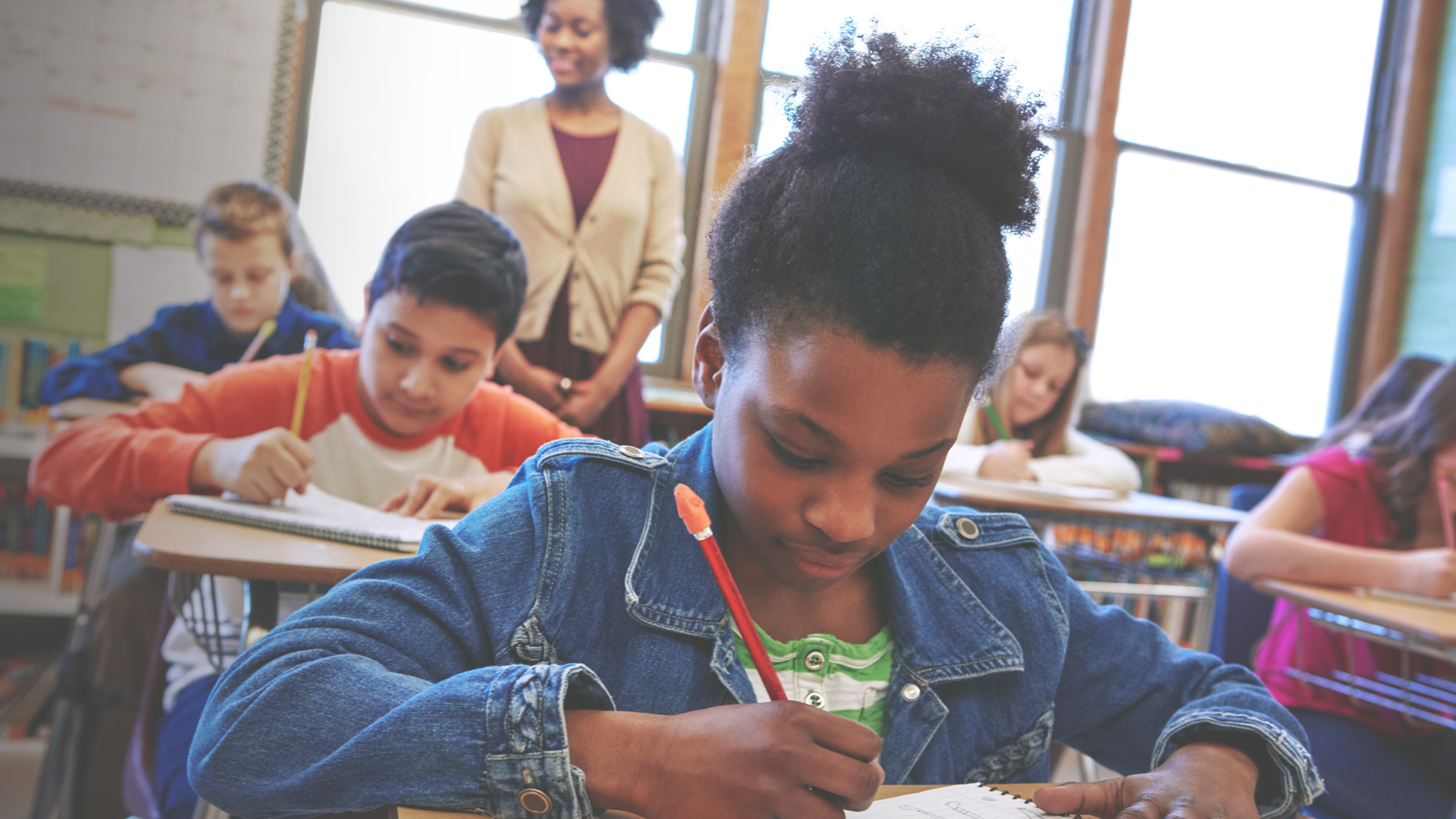 Girl taking a test in class