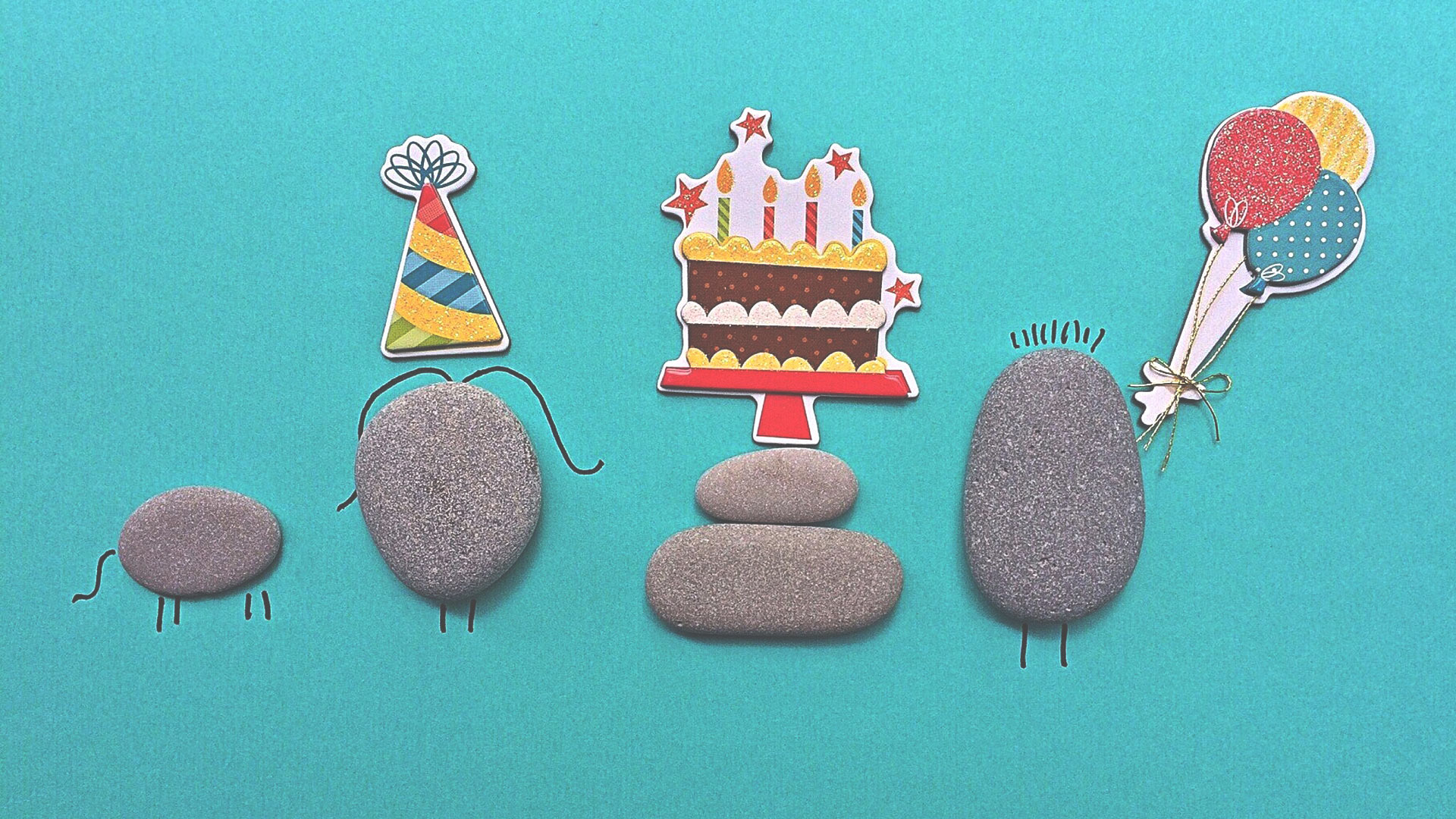Stones standing in as people celebrating a birthday party